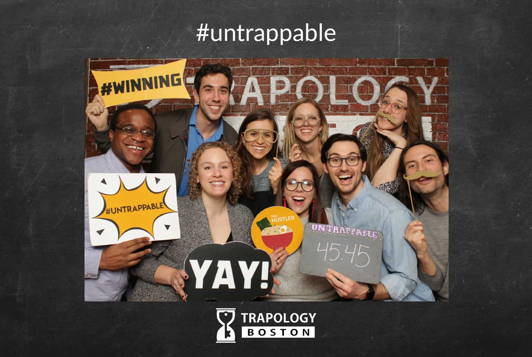 Escape rooms strengthen teams just like this one! A group of smiling successful escapees!